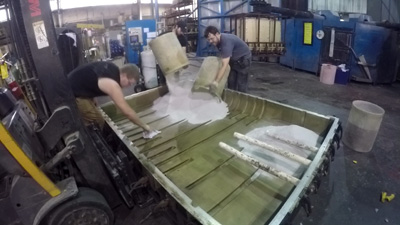 Powder benig loaded into mold, Rotomolding materials being loaded